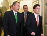 PHOTO: Speaker of the House John Boehner, R-Ohio, center, and House Majority Leader Eric Cantor, R-Va., right, arrive for the House Republican Conference meeting on the fiscal cliff legislation in the Capitol, Jan. 1, 2013.