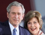"""PHOTO: Former President George W. Bush and Mrs. Laura Bush wave to friends as they leave the stage during a """"Welcome Home"""" Celebration, Jan. 20, 2009 in Midland, Texas."""