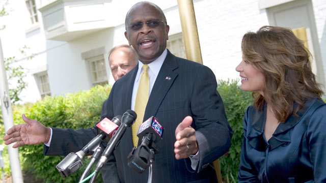 PHOTO: Rep. Michele Bachmann, R-Minn., appeared at the Capitol Hill Club with former GOP presidential contender Herman Cain, who announced his support for Mitch Romney to be President, May 16, 2012.