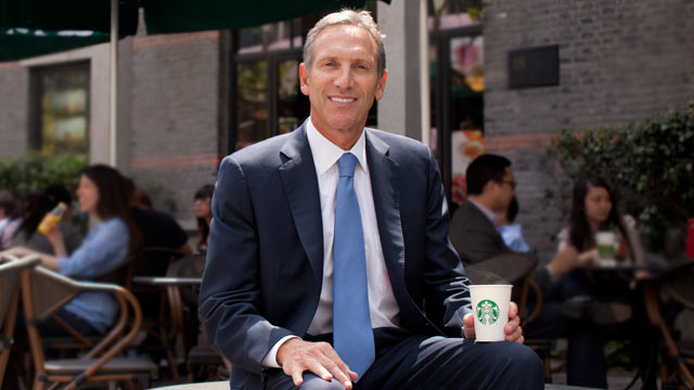 PHOTO: Howard Schultz, chief executive officer of Starbucks Corp. poses for a photograph outside one of the company's coffee shops, Shanghai, China, April 26, 2011.