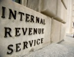 PHOTO: IRS employees exit the US Internal Revenue Service building at the end of the day in Washington, DC, March 20, 2012.