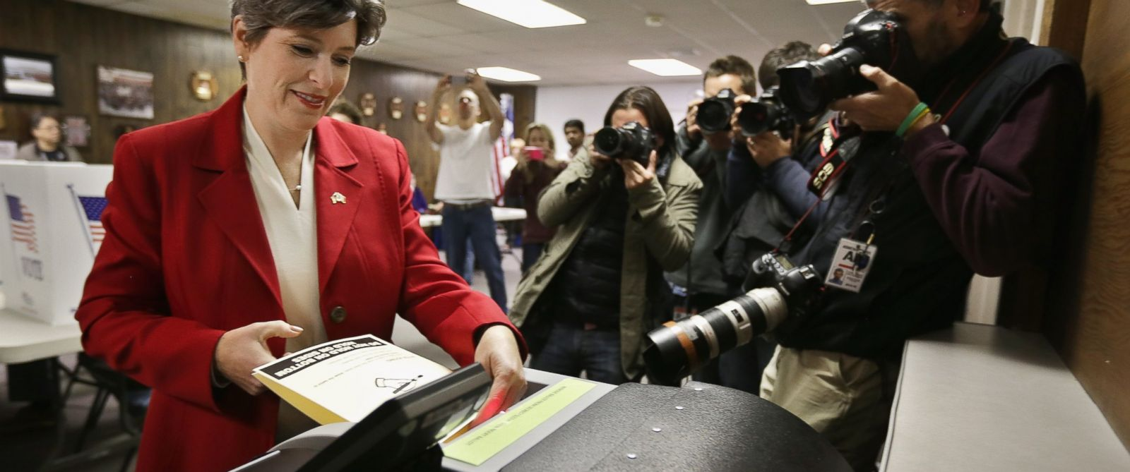 PHOTO: Republican U.S. Senate candidate Joni Ernst casts her ballot on election day at the polling place in her hometown fire department, Nov. 4, 2014 in Red Oak, Iowa.