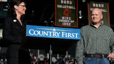 "PHOTO: Joe Wurzelbacher looks on as Sarah Palin speaks October 29, 2008 at Bowling Green University in Bowling Green, Ohio. Joe Wurzelbacher, also known as ""Joe the plumber"" of Holland, Ohio, campaigned with Palin for the first time at the event."