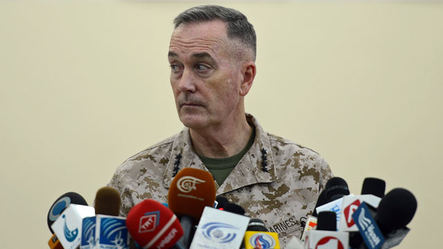 PHOTO: Gen. Joseph Dunford, Commander of the international coalition in Afghanistan, speaks during a ceremony to hand over Bagram prison to the Afghanistan government at Bagram Prison facilities on March 25, 2012.