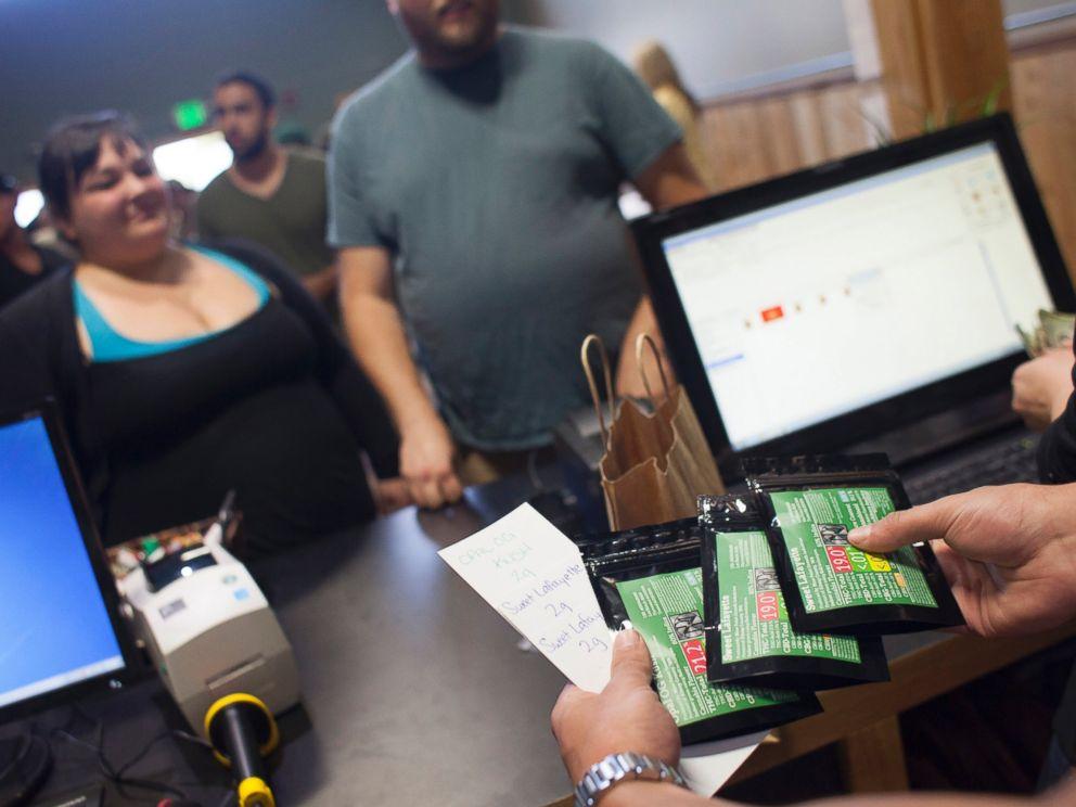 PHOTO: Customers purchase marijuana at Top Shelf Cannabis, a retail marijuana store, on July 8, 2014 in Bellingham, Washington.