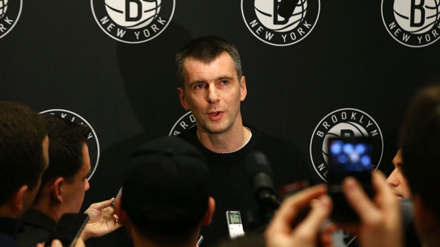 PHOTO: Brooklyn Nets owner Mikhail Prokhorov speaks to the media during half time of a game against the Charlotte Bobcats at Barclays Center, Dec. 28, 2012, in the Brooklyn borough of New York City.
