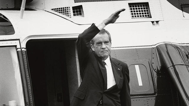 PHOTO: U.S. President Richard Nixon stands on the steps of the presidential helicopter as he waves goodbye to the White House for the final time after resigning the presidency Aug. 9, 1974 in Washington, D.C.