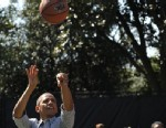 PHOTO: President Barack Obama takes a shot while playing basketball with children during the annual Easter Egg Roll, April 1, 2013, on the South Lawn of the White House in Washington, DC.