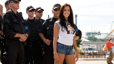 PHOTO: Amber Lee Ettinger aka Obama Girl poses with Lakewood, Colo., police officers outside of the Pepsi Center in Denver during the 2008 Democratic National Convention, Aug. 27, 2008.