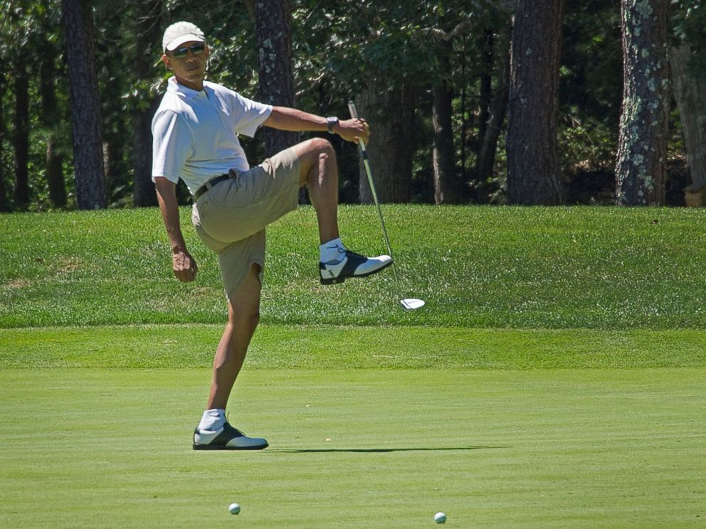 PHOTO: President Barack Obama reacts to a missed putt on the first green at Farm Neck Golf Club in Oak Bluffs, Mass. on August 11, 2013 during the Obama family vacation to Marthas Vineyard.