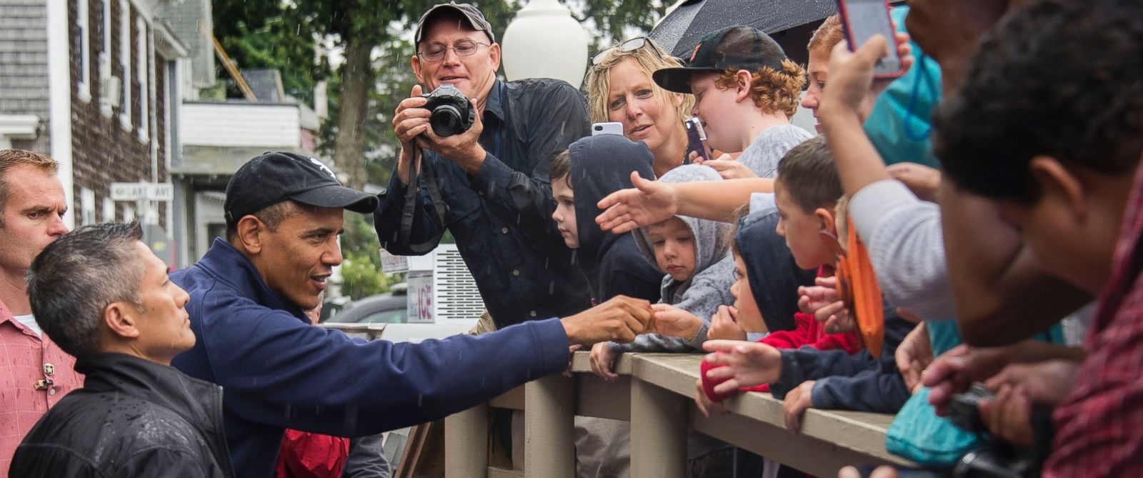 PHOTO: President Barack Obama shakes hands with people as he arrives at Nancys restaurant in Oak Bluffs, Mass. on August 13, 2013.