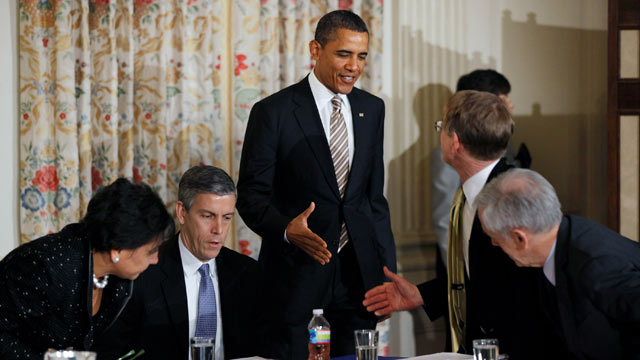 PHOTO: U.S. President Barack Obama, center, greets members of his Council on Jobs and Competitiveness while Education Secretary Arne Duncan, second from left, looks over documents before a meeting of council at the White House in Washington, D.C., Jan. 17