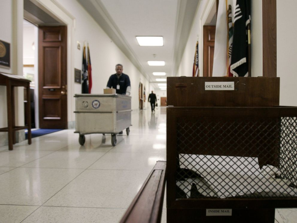 PHOTO: A mail bin fills up in the hallways of the Rayburn Building along with furniture, lamps and boxes from offices being moved and cleaned out on Dec. 13, 2006 on Capitol Hill in Washington, D.C.