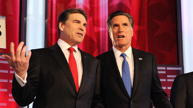 PHOTO: Rick Perry, left, and Mitt Romney await for the start of the GOP debate on the campus of Drake University in this Dec. 10, 2011 file photo.