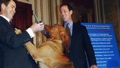 PHOTO: Sen. Rick Santorum, right, with bloodhounds at a news conference of GOP Senate leadership.
