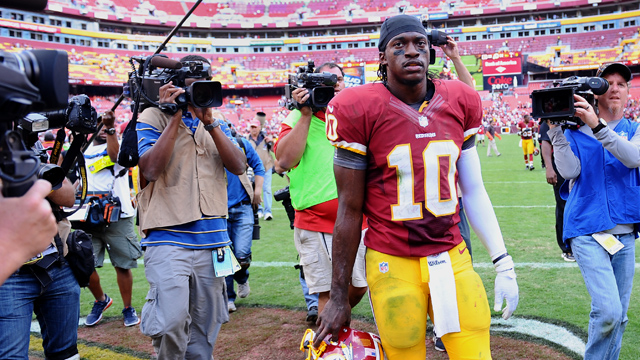 PHOTO: Washington Redskins quarterback Robert Griffin III leaves the field, Sept. 23, 2012 at FedE Field in Landover, MD.