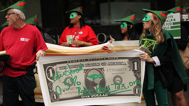 PHOTO: The U.S. Robin Hood Tax Campaign protest outside JP Morgan Stanley Corporate Headquaters on June 19, 2012 in New York City.