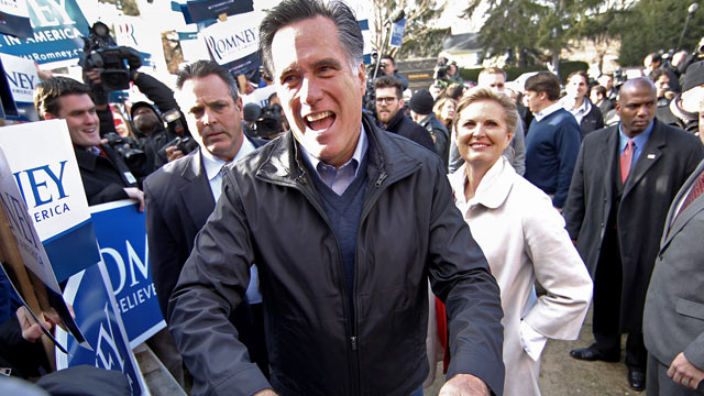 PHOTO: Mitt Romney with his wife Ann at the Webster School polls, January 10, 2012.