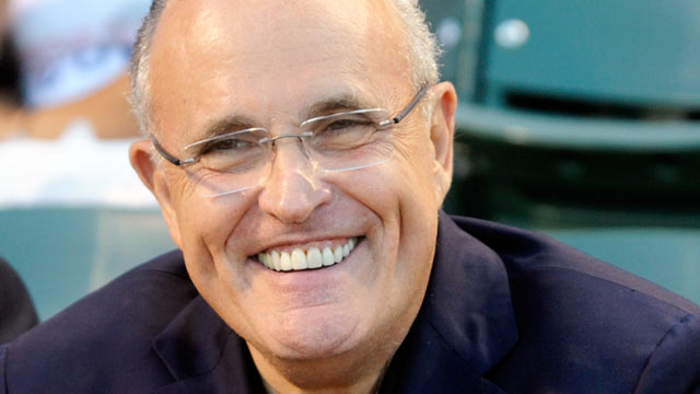 PHOTO: Rudy Giuliani smiles before the game between the Chicago Cubs and the Atlanta Braves, August 22, 2011 at Wrigley Field in Chicago, Illinois.