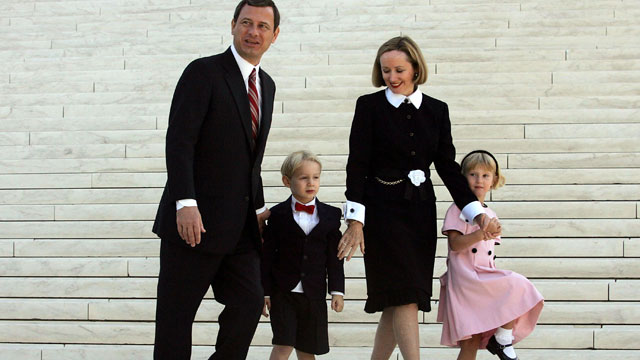 PHOTO: Chief Justice John Roberts walks with his wife Jane Roberts and their children Jack Roberts and Josie Roberts at the Supreme Court after he took the Supreme Court bench for the first time October 3, 2005 in Washington, DC.