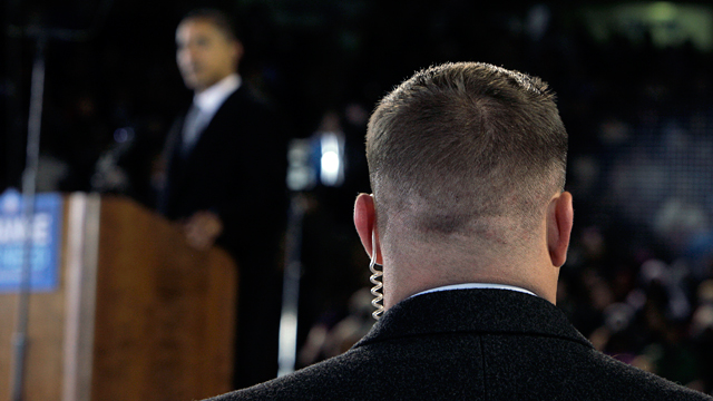 PHOTO: A Secret Service agent stands near then presidential candidate Barack Obama, background, at a rally in this file photo.