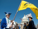 PHOTO: Tea party activists Bob Mason, left and John Oltesvig, both of North Carolina, wear colonial costumes with tri-corner hats as they participate in the rally at the Capitol, April 6, 2012.