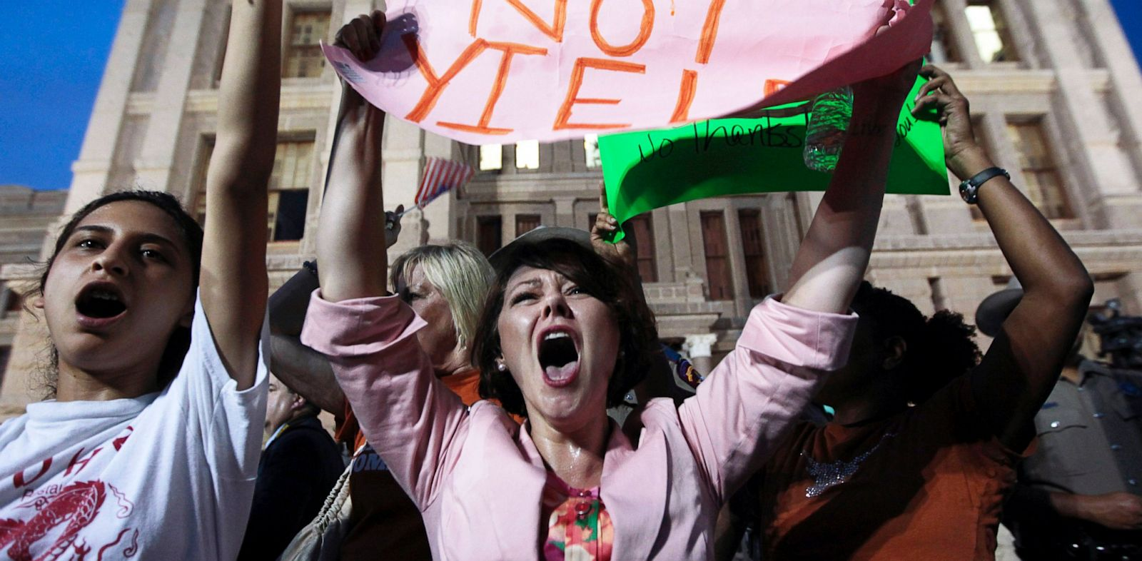 PHOTO: Pro-choice protester Julia Ann Nitsch of Austin, center, chants as pro-life supporters and pro-choice protesters rally at the Texas state capitol in favor and against the new controversial abortion legislation up for a vote in the state legislature