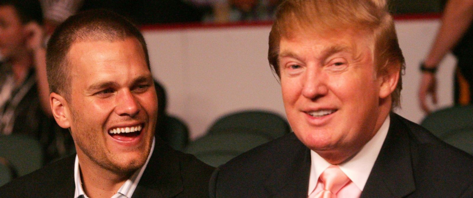 PHOTO: New England Patriots quarterback Tom Brady chats with Donald Trump.