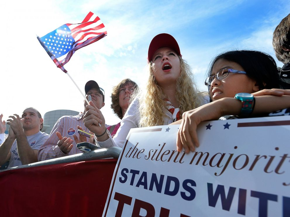 PHOTO: Donald Trump supporters cheer for the Republican presidential while he speaks at a rally in front of the USS Wisconsin on Oct. 31, 2015 in Norfolk, Va.