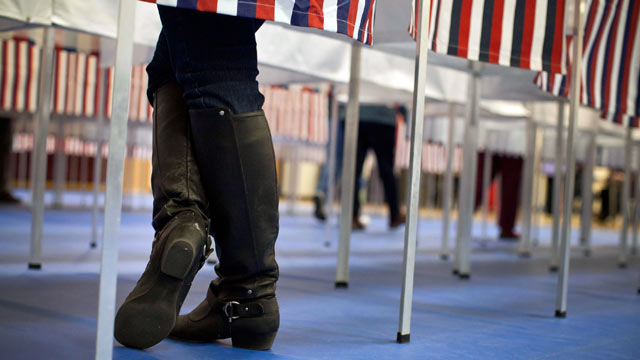 PHOTO: A woman votes in the New Hampshire primary at Bedford High School on Jan. 10, 2012 in Bedford, New Hampshire.