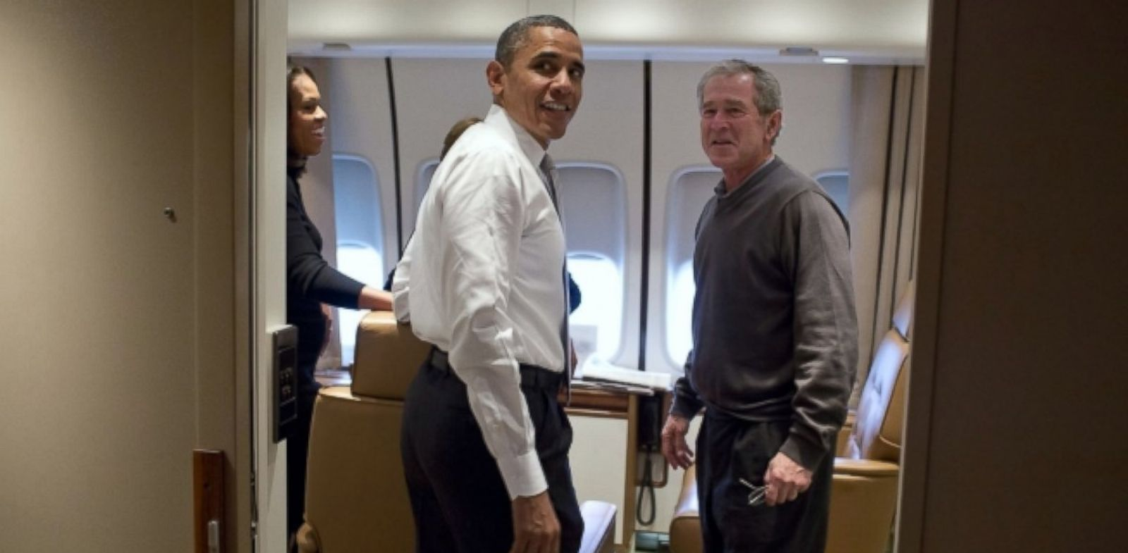 President Barack Obama jokes with former President George W. Bush shortly after boarding Air Force One for the trip to South Africa, Dec. 9, 2013.
