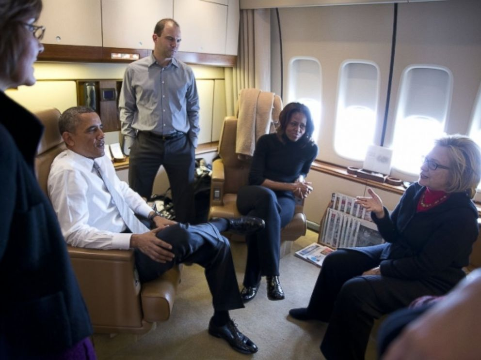 Former Secretary of State Hillary Clinton talks with the Obamas, Ben Rhodes and Capricia Marshall aboard Air Force One, Dec. 9, 2013.