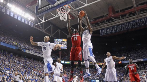PHOTO: Julius Randle of the Kentucky Wildcats grabs a rebound over Mangok Mathiang of the Louisville Cardinals at Rupp Arena in Lexington, Kent. on Dec. 28, 2013.