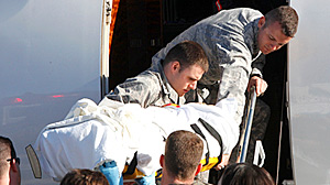 PHOTO U.S. Rep. Gabrielle Giffords, D-Ariz., is lifted onto an airplane, Jan. 21, 2011. Giffords will begin the next phase of her recovery from a gunshot wound at TIRR Memorial Hermann Rehabilitation Hospital.