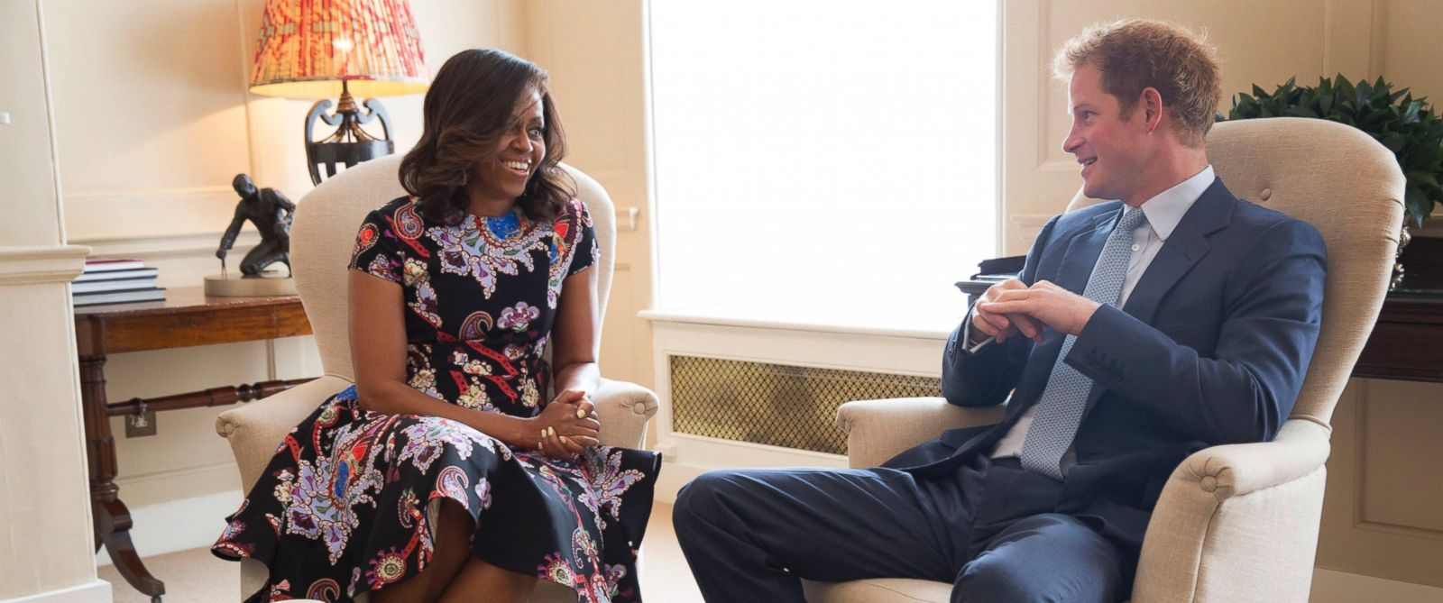"""PHOTO: First Lady Michelle Obama meets with Prince Harry for tea to discuss the """"Let Girls Learn"""" initiative and support for veterans, at Kensington Palace in London, England, June 16, 2015."""