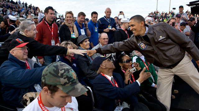 PHOTO: President Barack Obama greets veterans before the Carrier Classic basketball game between the University of North Carolina Tar Heels