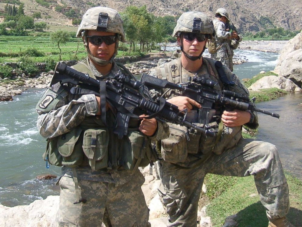 PHOTO: Sgt. Ryan Pitts and Sgt. Israel Garcia patrol the area near the village of Rechalam, Afghanistan, which is west of Forward Operating Base Blessing, in the summer of 2007.