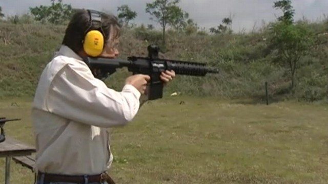 VIDEO: Governor Rick Perry fires assault rifle at gun range.