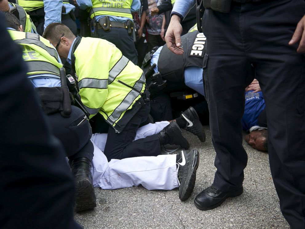 PHOTO: Police detain people after a fight between supporters and opponents of U.S. Republican presidential candidate Donald Trump, ahead of his speech outside the Peabody Opera House in St. Louis, Missouri, March 11, 2016.