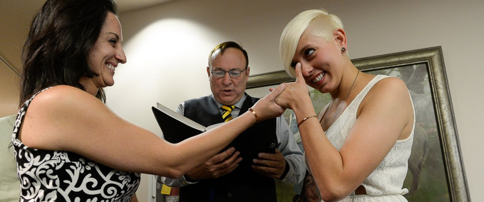 PHOTO: Sen. Jim Dabakis marries Yolanda Pascua and Laekin Rogers on Oct. 6, 2014, at the Salt Lake County Complex in Utah.