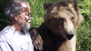 Grizzly with paw on Charlies shoulder
