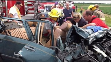 PHOTO: Witnesses claim a mystery man saved a car crash victim with a prayer