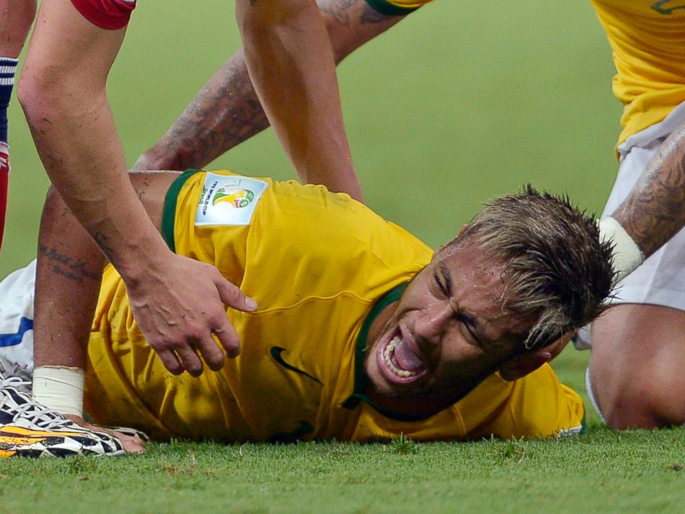 PHOTO: Brazils Neymar screams out after being fouled during the World Cup quarterfinal soccer match between Brazil and Colombia at the Arena Castelao in Fortaleza, Brazil, July 4, 2014.