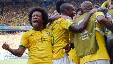 PHOTO: Brazilian players celebrate after Brazils opening goal during the World Cup round of 16 soccer match between Brazil and Chile at the Mineirao Stadium in Belo Horizonte, Brazil, June 28, 2014.