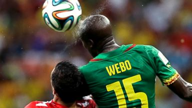 PHOTO: Cameroons Pierre Webo, right, and Croatias Darijo Srna battle for the ball during the group a World Cup soccer match between Cameroon and Croatia at the Arena da Amazonia in Manaus, Brazil, June 18, 2014.