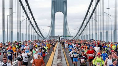 PHOTO: Police and U.S. Coast Guard helicopters fly overhead as runners cross the Verrazano-Narrows Bridge at the start of the New York City Marathon, Sunday, Nov. 3, 2013, in New York.