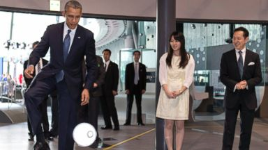 PHOTO: President Barack Obama kicks a ball passed to him by a robot named ASIMO at the National Museum of Emerging Science and Innovation, known as the Miraikan, in Tokyo, Japan on April 24, 2014.