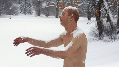 PHOTO: A statue of a man sleepwalking in his underpants is surrounded by snow on the campus of Wellesley College, in Wellesley, Mass., Feb. 5, 2014.