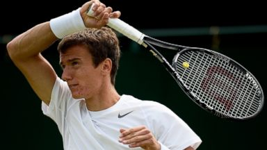 PHOTO: Andrey Kuznetsov of Russia plays during his Gentlemens Singles second round match at the Wimbledon Lawn Tennis Championships, June 26, 2013, in London.