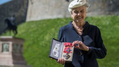 PHOTO: Actress Angela Lansbury poses with her Dame Commander (DBE) medal given to her by Queen Elizabeth II at an Investiture ceremony at Windsor Castle, April 15, 2014 in Berkshire, England.